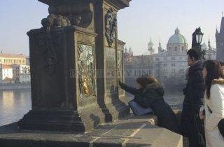 Charles Bridge  - Statue of John of Nepomuk (or John Nepomucene) is a national saint of the Czech Republic